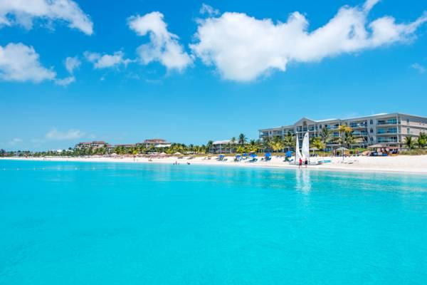 mejores playas del mundo Grace Bay Providenciales, en Islas Turcas y Caicos trending magazine